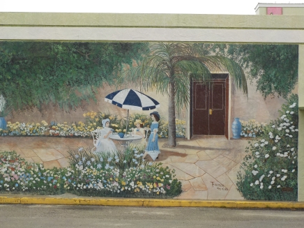 """Lake Placid's first mural by Tom Freeman, 1993: """"Tea at Southwinds"""" the successor resort to one owned by the inventor of the Dewey Decimal System"""