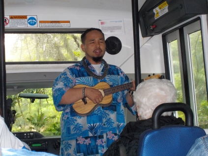 A guide serenades us.