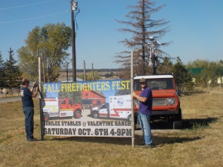 Norwood, Retired Chicago fireman, now Chief of the Fire Department and an aid prepare for the annual fundraiser.