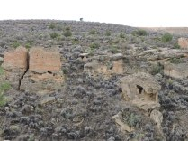 Twin Towers on left; Eroded Boulder House on right: Hovenweep National Park