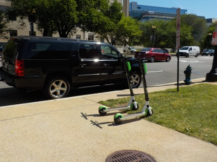 Black SUVs are the limo of choice today in D.C. although most are Lincolns. Others use these rental scooters found everywhere.