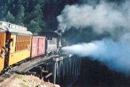 The engine blows off excess steam when the track levels out.