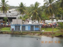 Madang: people watching the ship come in.