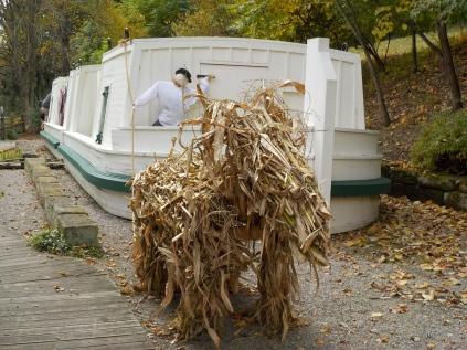 "A ""mule"" made of cornstalks pulls the canal boat replica."