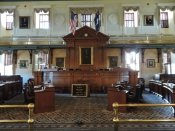 The South Carolina Senate has 46 Senators elected for four year terms. The large center desk was hand-carved in 1915.